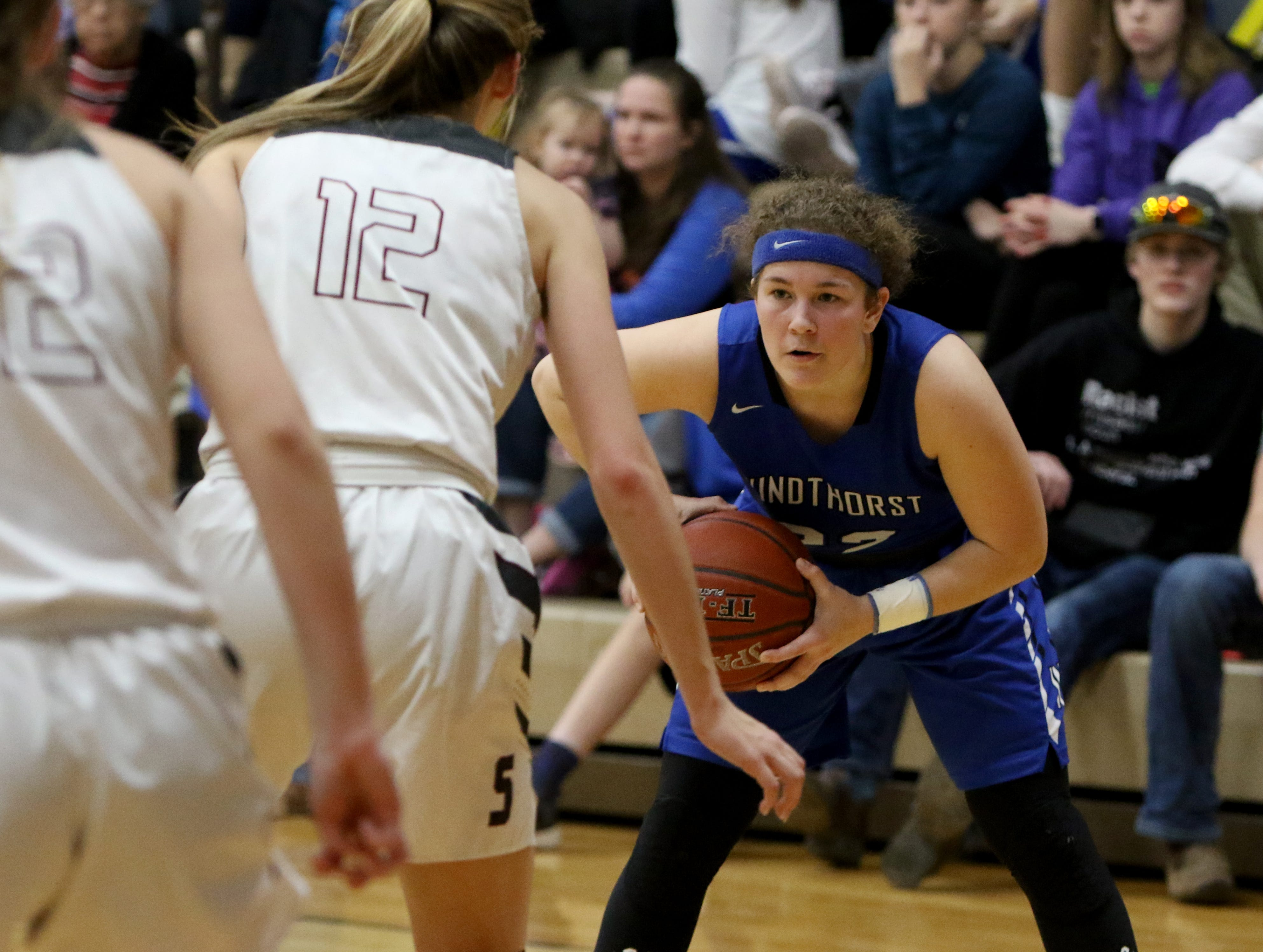Windthorst's Abby Brown holds the ball while guarded by Seymour's Tess Decker Tuesday, Jan. 8, 2019, in Seymour.