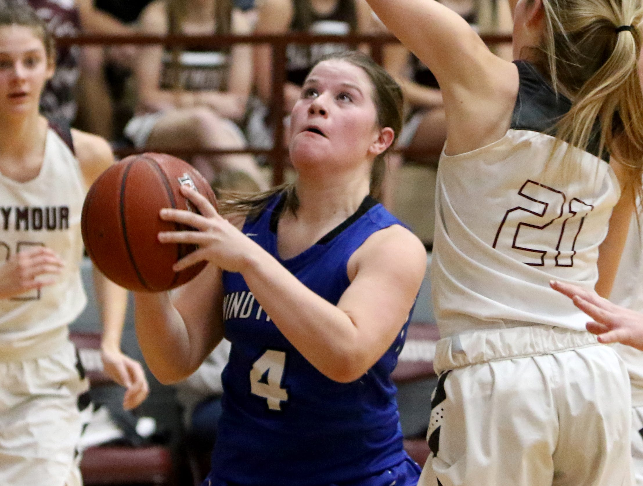 Windthorst's Claire Hemmi looks to the basket by Seymour's Kennedy Stroebel Tuesday, Jan.8, 2019, in Seymour.