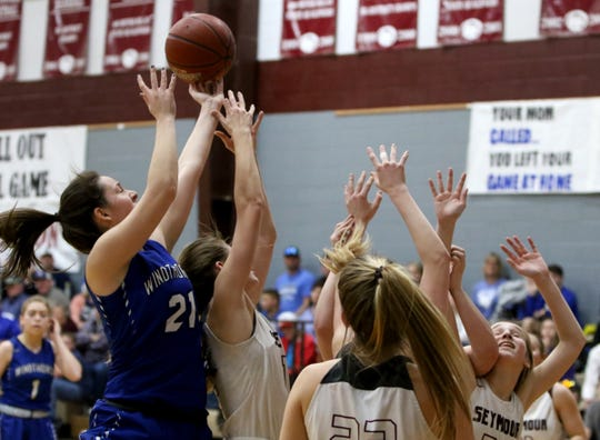 Windthorst's Mollee Kirk (21) gets the rebound in the game against Seymour Tuesday, Jan.8, 2019, in Seymour.