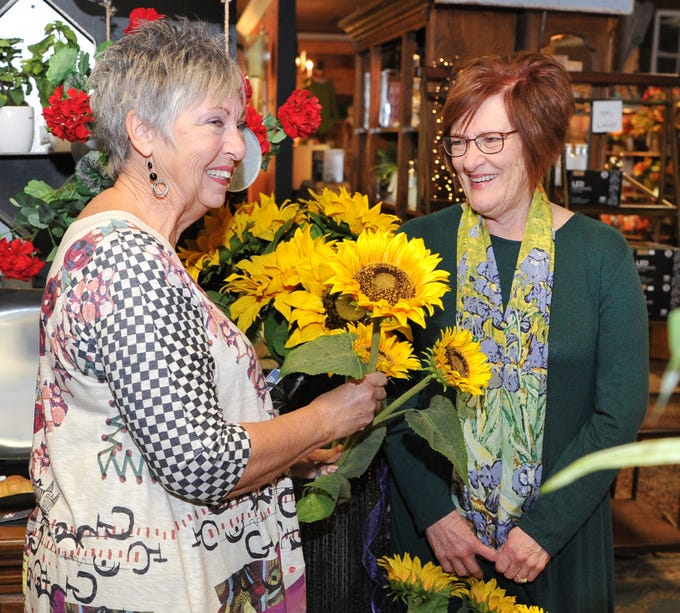 The Last Straw co-owners, Nelda Hickman, left, and Cheryl Beer talk after announcing they will be closing their store after 31 years of business in Wichita Falls.