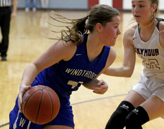 Windthorst's Claire Hemmi drives to the basket by Seymour's Channing Stroebel Tuesday, Jan.8, 2019, in Seymour.