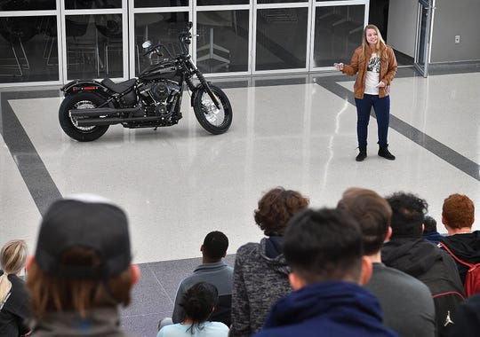 Bobbie Gilmore, team leader for Red River Harley Davidson, talks with students at the Career Education Center about a collaboration to customize a 2019 HD Street Bob Softtail for a competition.