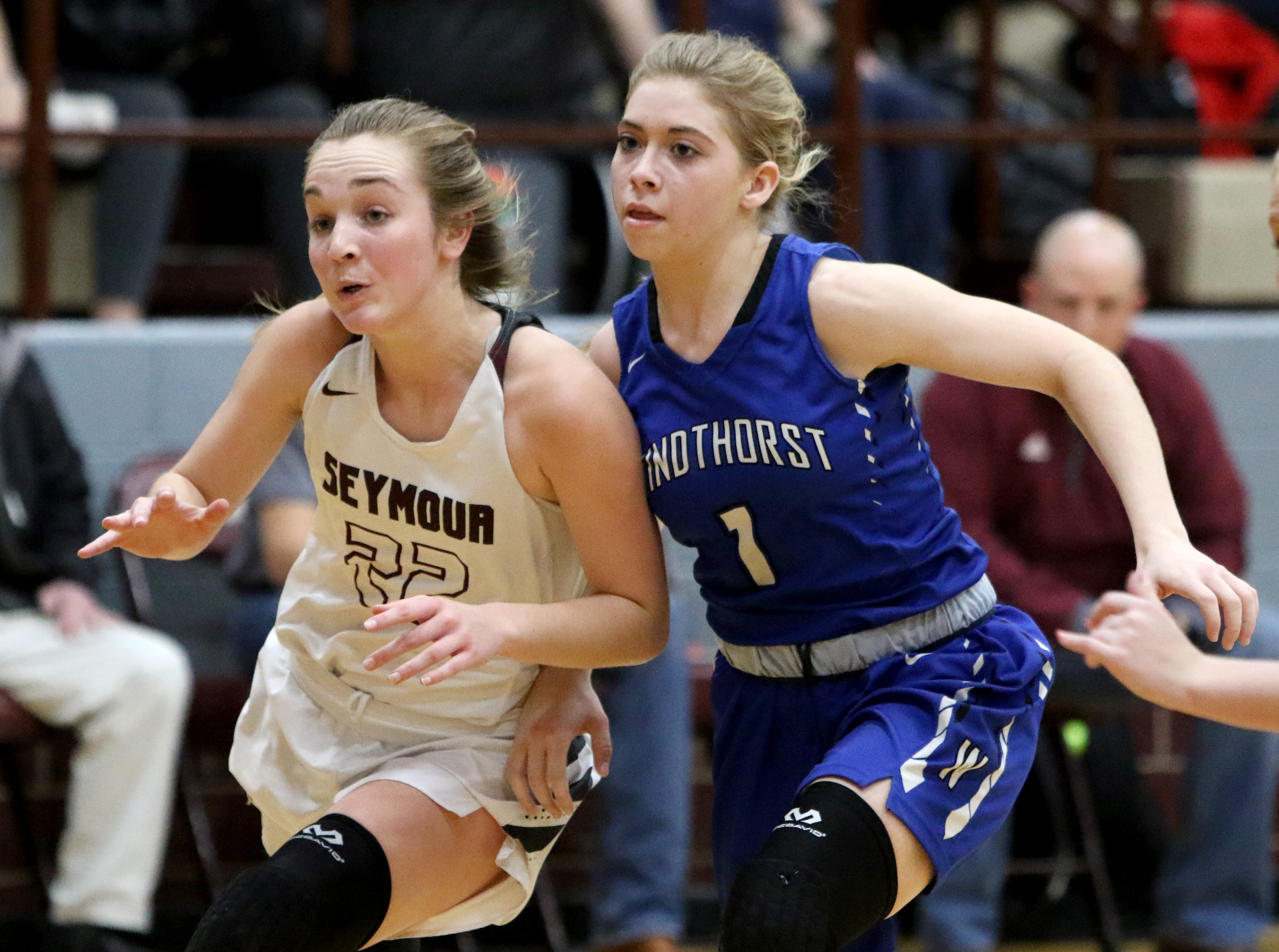 Seymour's Channing Stroebel, left, and Windthorst's Kora Pennartz fight for position Tuesday, Jan.8, 2019, in Seymour.