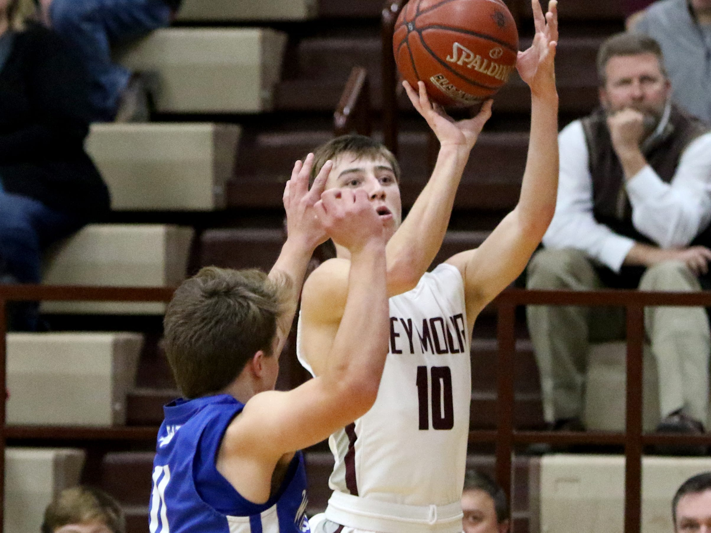 Seymour's Garrett Siegert shoots from three-point range against Windthorst Tuesday, Jan. 8, 2019, in Seymour.