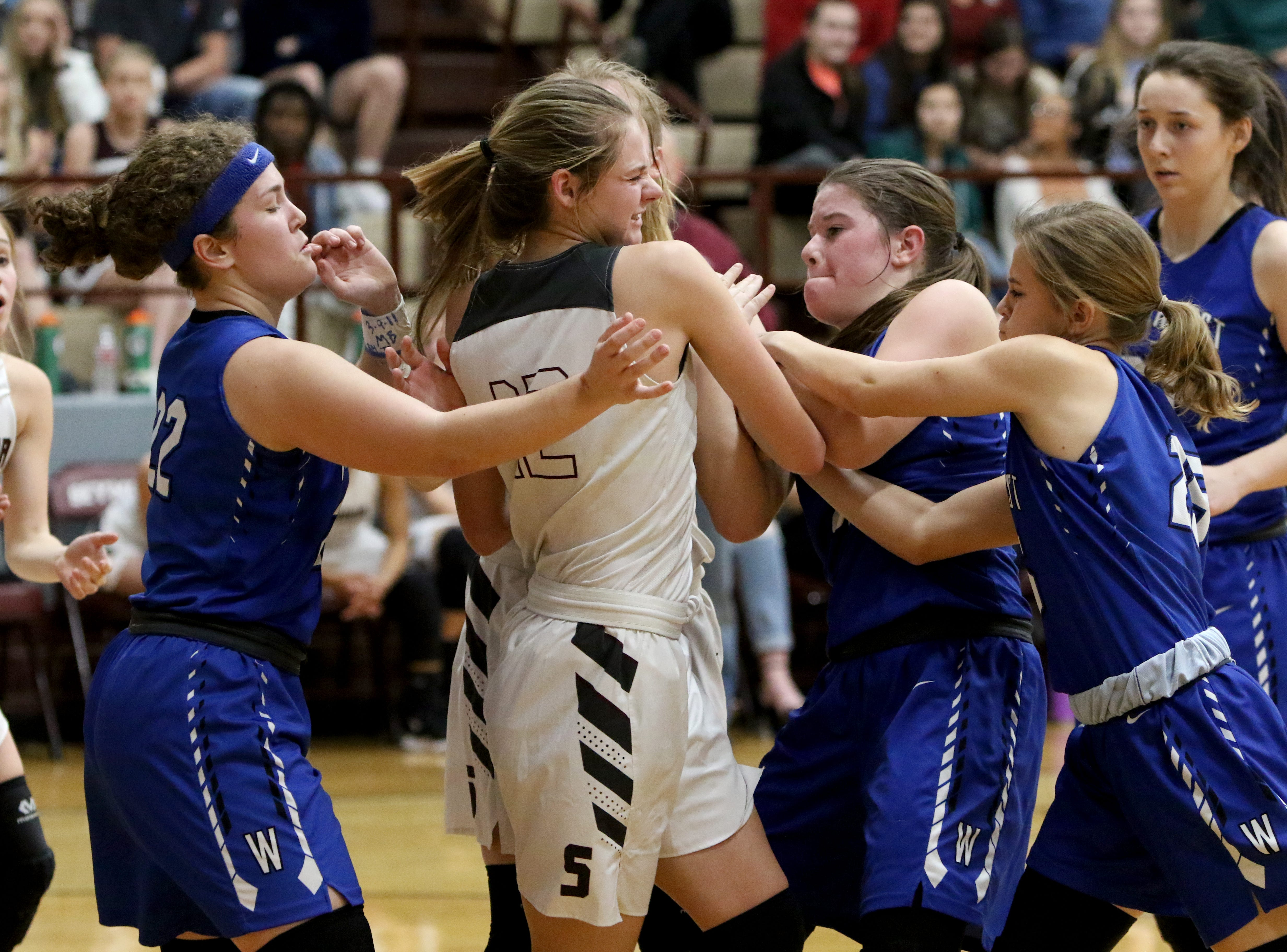 Seymour's Tess Decker tries to keep the ball as Windthorst's Abby Brown, left, Claire Hemmi and Sadie Anderle reach in Tuesday, Jan.8, 2019, in Seymour.