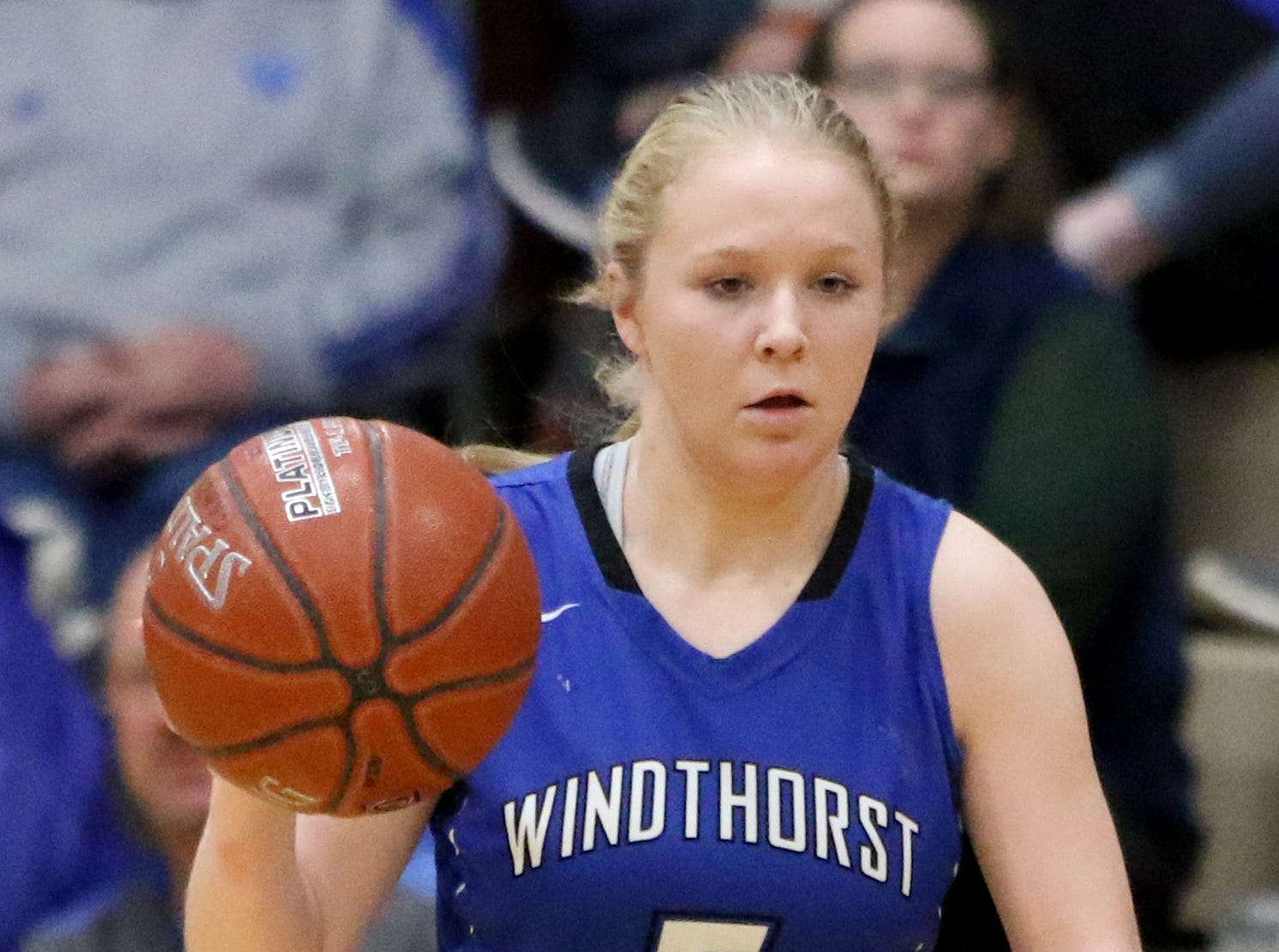 Windthorst's Grace Hoegger dribbles in the game against Seymour Tuesday, Jan.8, 2019, in Seymour.