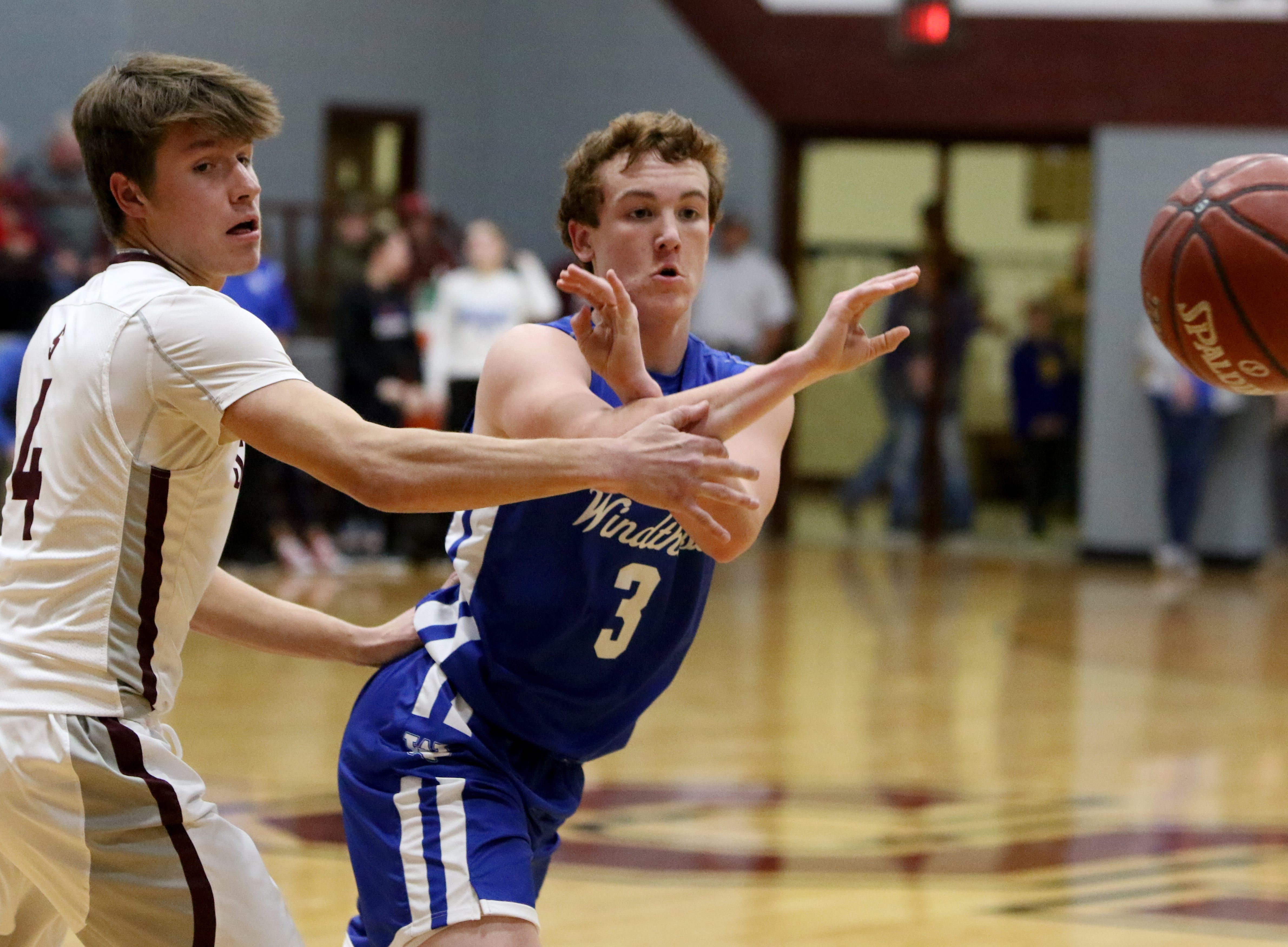 Windthorst's Cy Belcher passes by Seymour's Cade Holden Tuesday, Jan. 8, 2019, in Seymour.