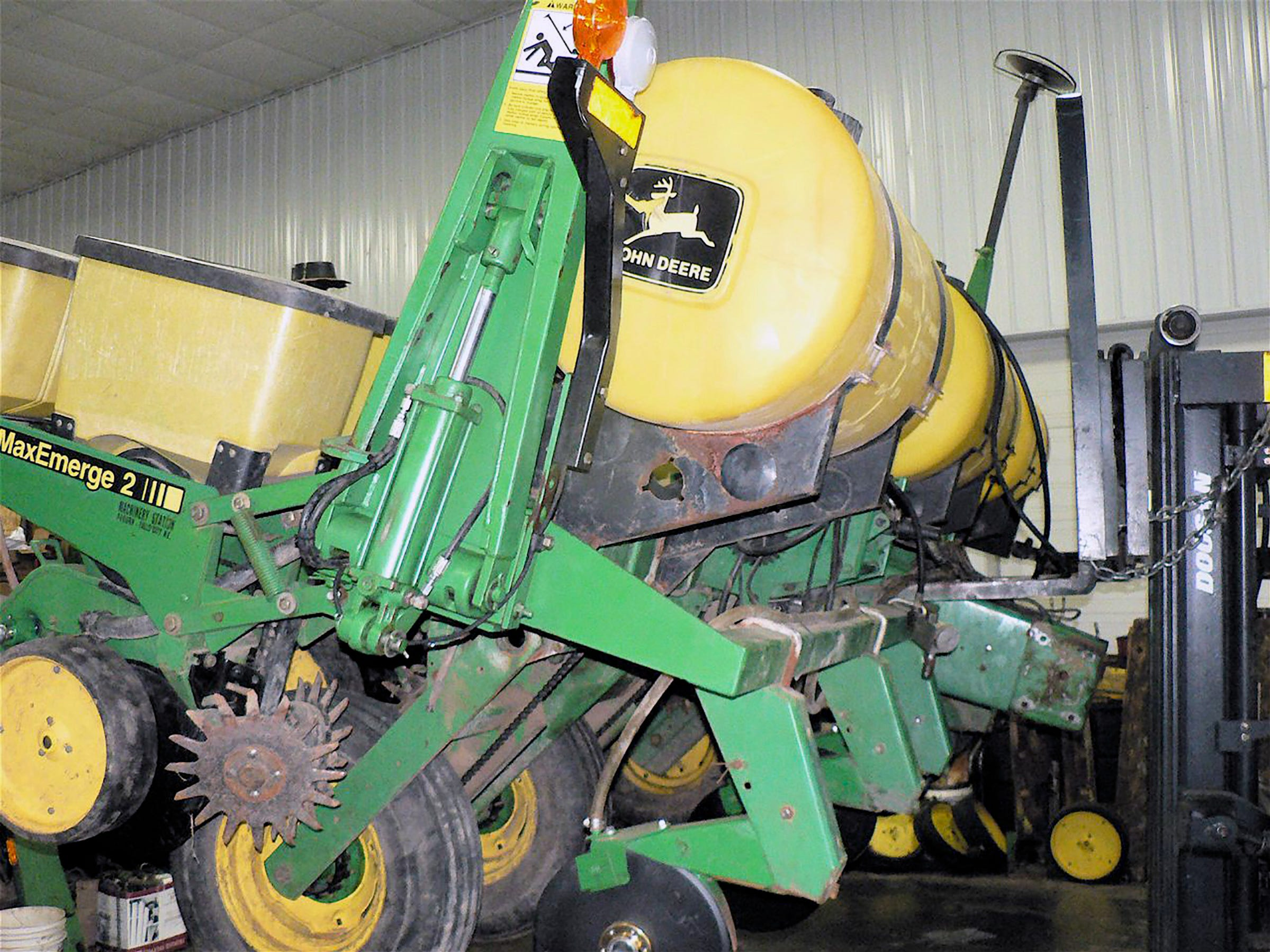 A six row planter on the hoist.