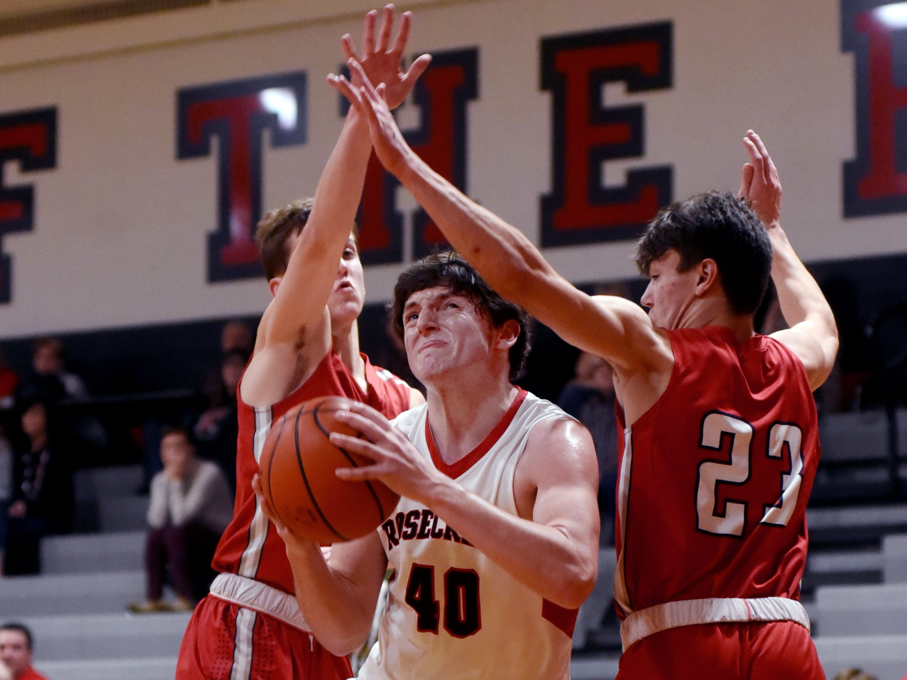 Matt Applegate, of Rosecrans, drives between a pair of defenders during the first half of the Bishops' 89-48 win against Fairfield Christian Academy on Tuesday in a Mid-State League-Cardinal Division game at Rogge Gymnasium. Applegate scored a game-high 20 points with nine rebounds.