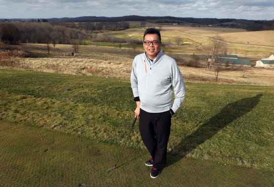 Hung Chow didn't start playing golf until his freshman year at Ohio State. Now he is general manager and head golf pro at The Virtues Golf Club.