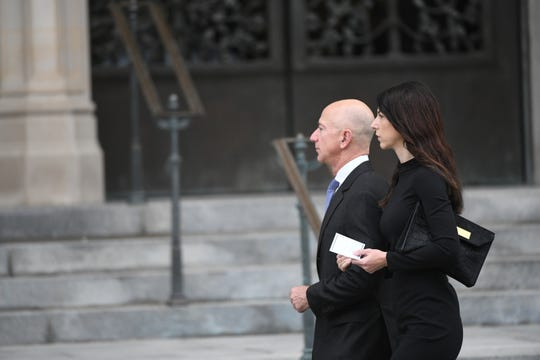 Jeff Bezos and his wife MacKenzie Bezos approach the National Cathedral in Washington for a memorial service for John McCain on Sept. 1, 2018.