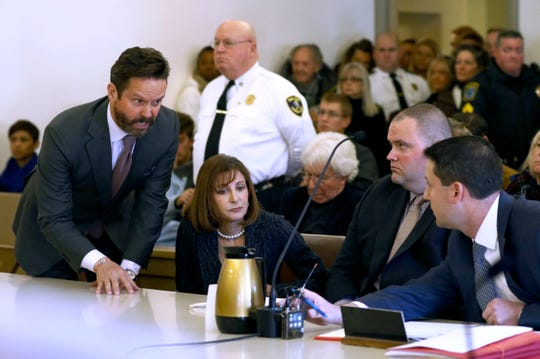 The tiny Nantucket, Mass., courtroom was jammed for Kevin Spacey's arraignment on Jan. 7, 2019. His lawyers, Alan Jackson and Juliane Balliro, confer with assistant district attorney Michael Giardino, far right.