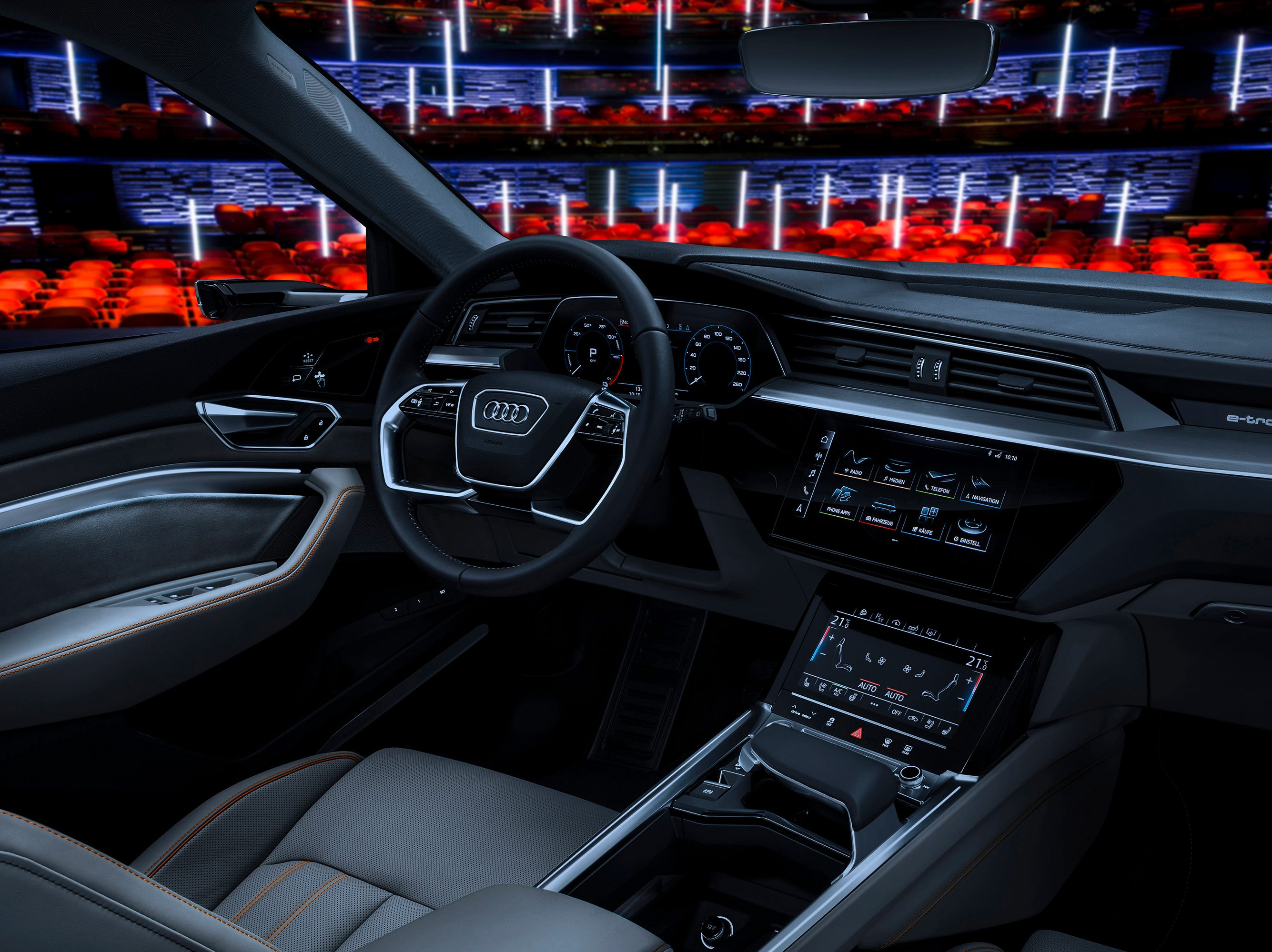 "Audi shows the Audi e-tron prototype on the stage in the Royal Danish Playhouse in Copenhagen. At CES Audi is showing a new entertainment format, which it says will transform a vehicle into a ""special movie theater experience."" For now, the system is designed to work only when the vehicle is stationary, but Audi imagines a world in which the car is so good at driving itself that its passengers will need some amusement to pass the time.  (Audi via AP) ORG XMIT: NYBZ902"