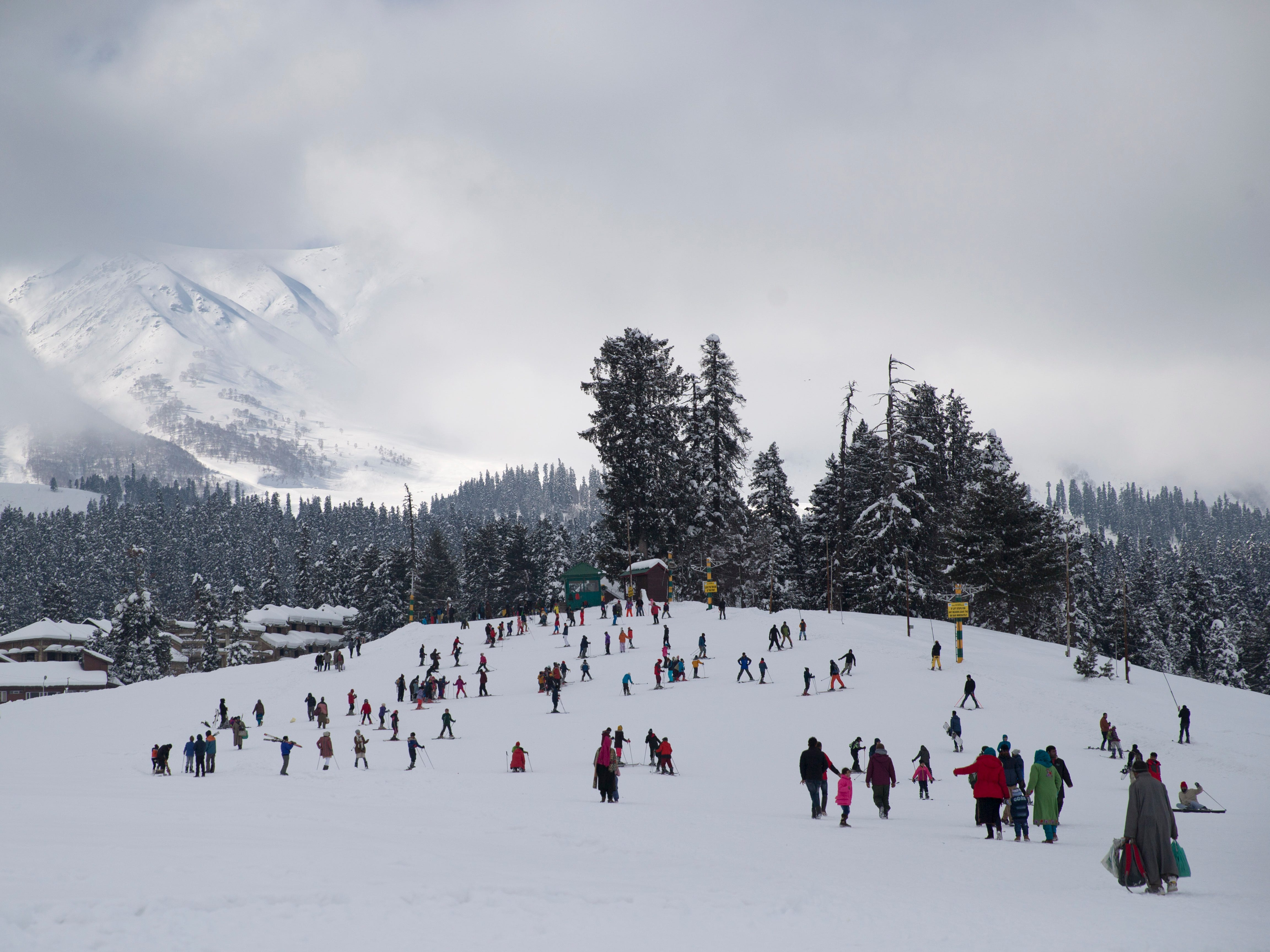 People ski on a slop in Gulmarg, north of Srinagar, Indian controlled Kashmir,  Jan 9. 2019.  Gulmarg which means meadow of flowers, was transformed into a resort by the British nearly a century ago. Located at 9,000 feet above sea level, it gets one to one-and-a-half meters of snow in the winter.