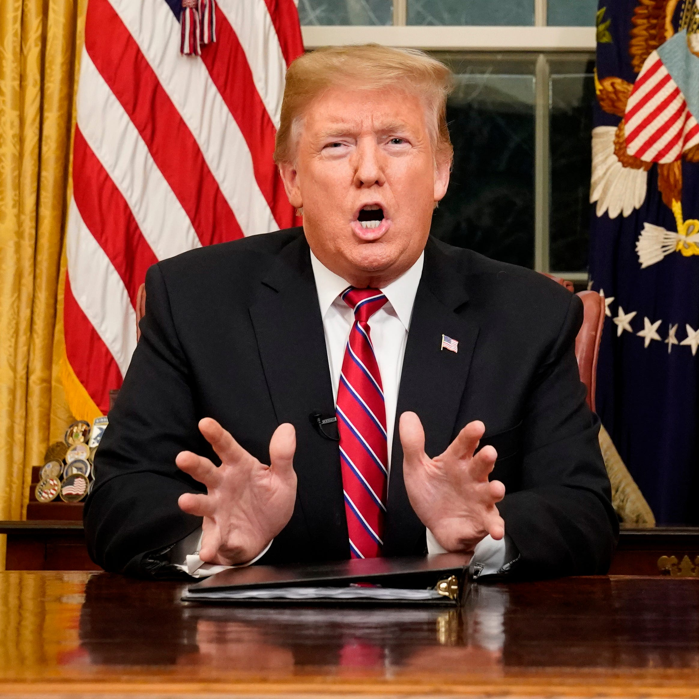 President Donald Trump speaks from the Oval Office of the White House as he gives a prime-time address about border security on Jan. 8, 2018.