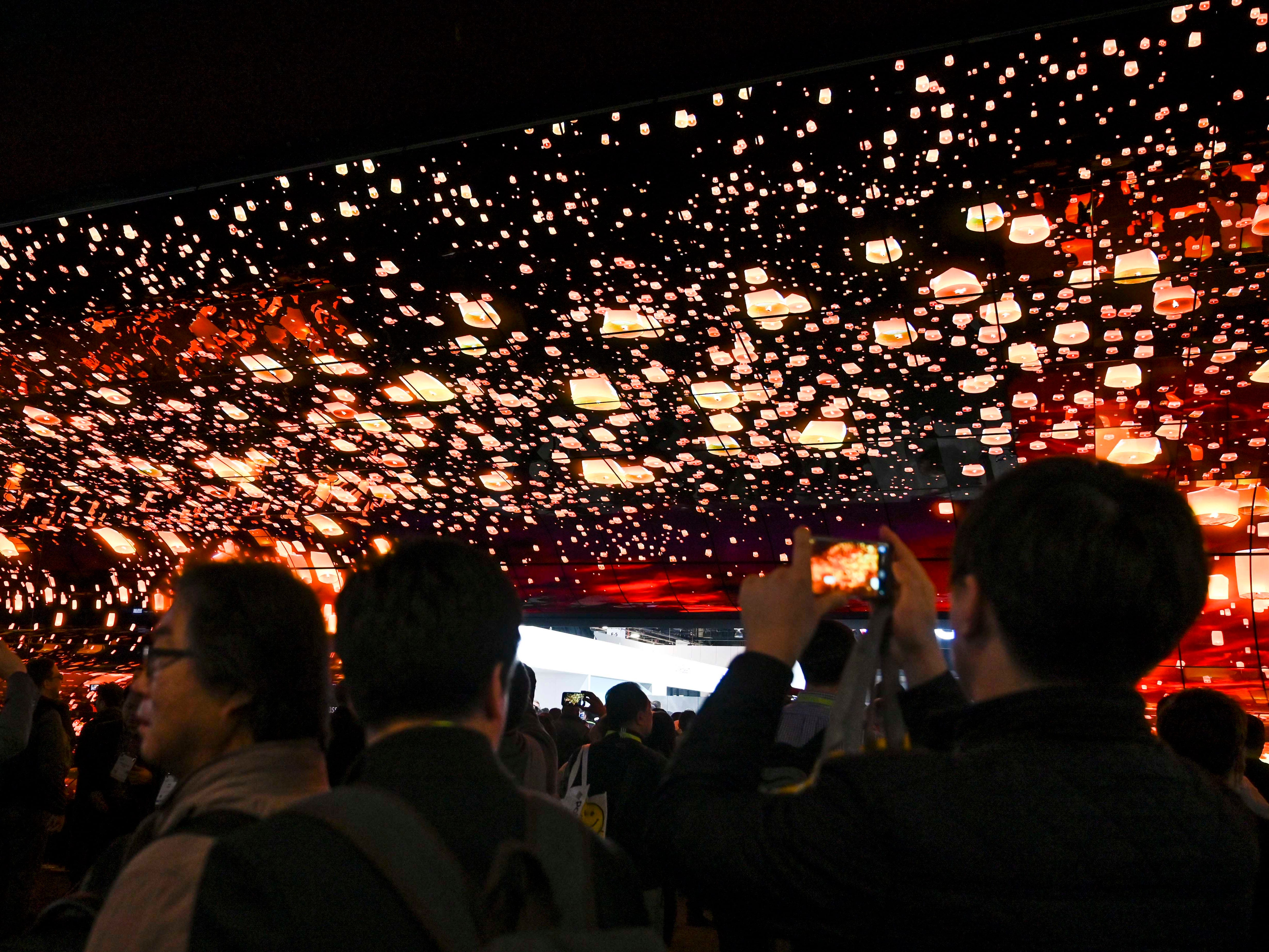 Crowds entering the LG display are greeted with a huge video array.