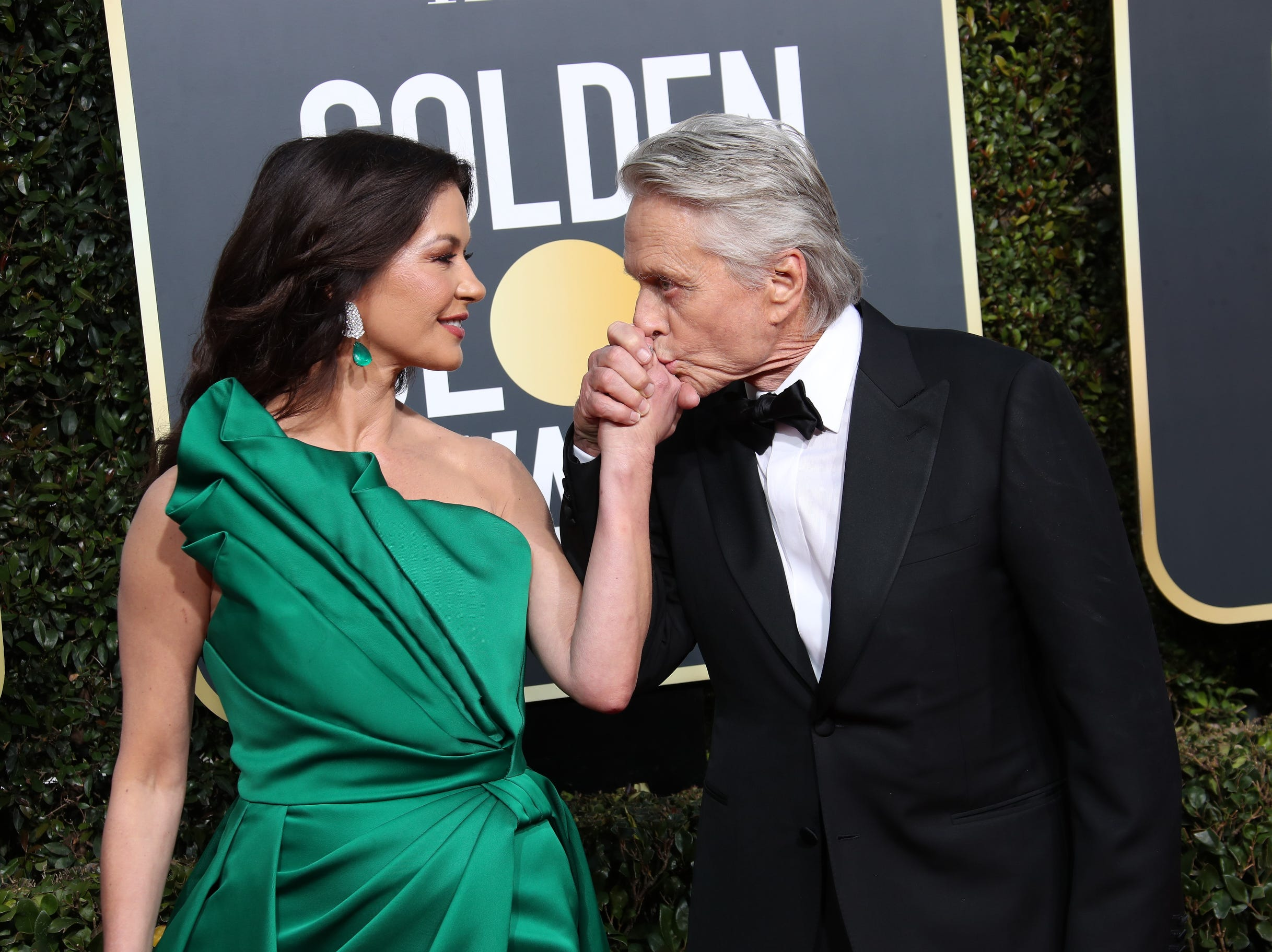 Catherine Zeta-Jones, left and Michael Douglas arrive at the Golden Globe Awards.
