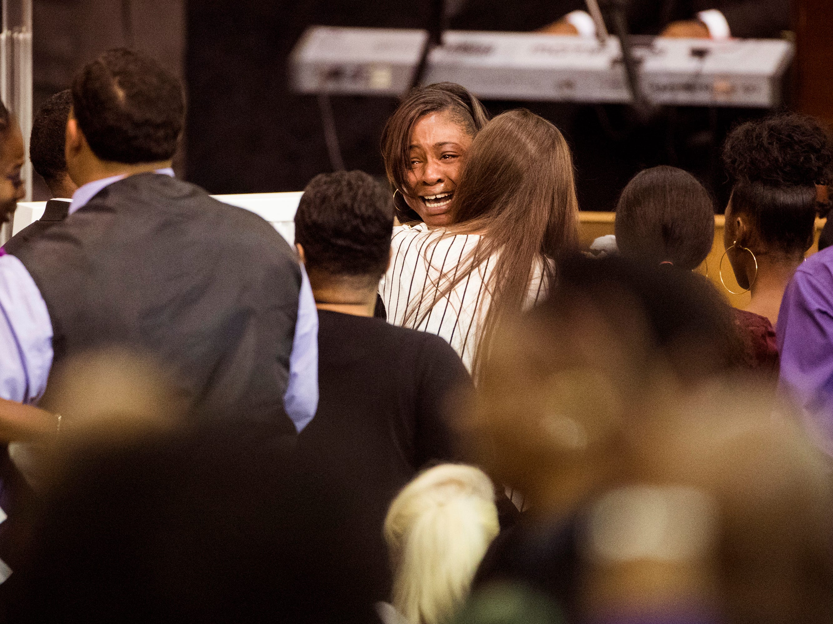 LaPorsha Washington, mother of Jazmine Barnes cries by the casket of her daughter during a memorial service.