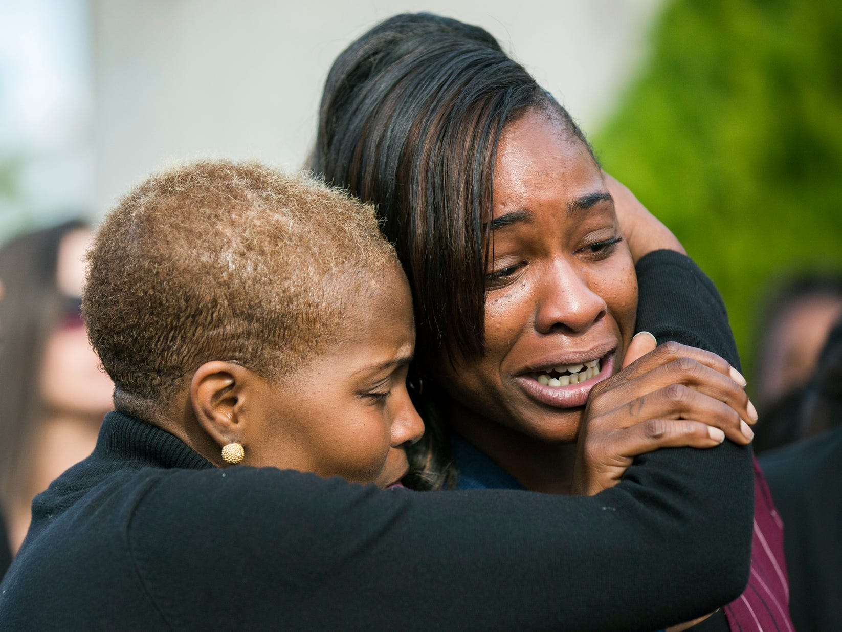 LaPorsha Washington, right, is embraced as she cries while the casket of her daughter Jazmine Barnes is placed inside a funeral hearse after a memorial service on Jan. 8, 2019, at The Community of Faith Church in Houston. Jazmine was fatally shot on Dec. 30, 2018, while in a car with her family during an attack that investigators say appears to be a case of mistaken identity.