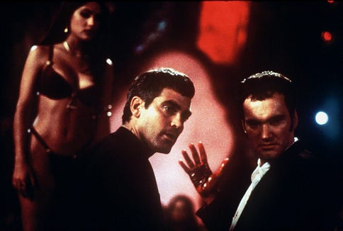 "The Gecko brothers (George Clooney, left, and Quentin Tarantino) visit a vampire-filled strip club in ""From Dusk Till Dawn."""