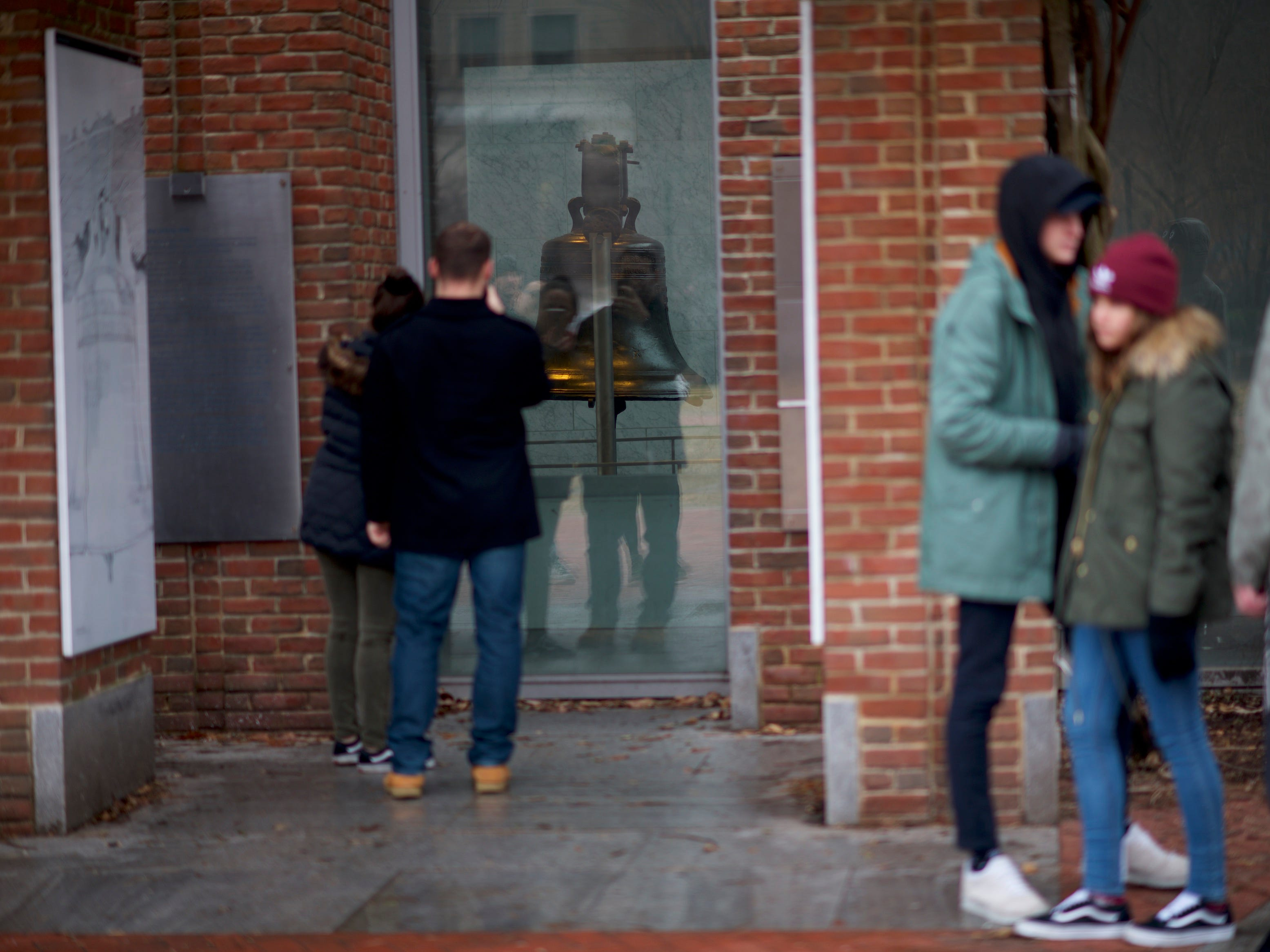 PHILADELPHIA, PA - JANUARY 08:  Tourists photograph the Liberty Bell, unable to go inside due to a lapse in federal appropriations on January 8, 2019 in Philadelphia, Pennsylvania.  Furloughed federal workers and area elected officials held a protest rally beside it on Independence Mall.  The government shutdown, now lasting 18 days, marks the second longest United States in history, affecting about 800,000 federal employees.  (Photo by Mark Makela/Getty Images) ORG XMIT: 775278689 ORIG FILE ID: 1079379568