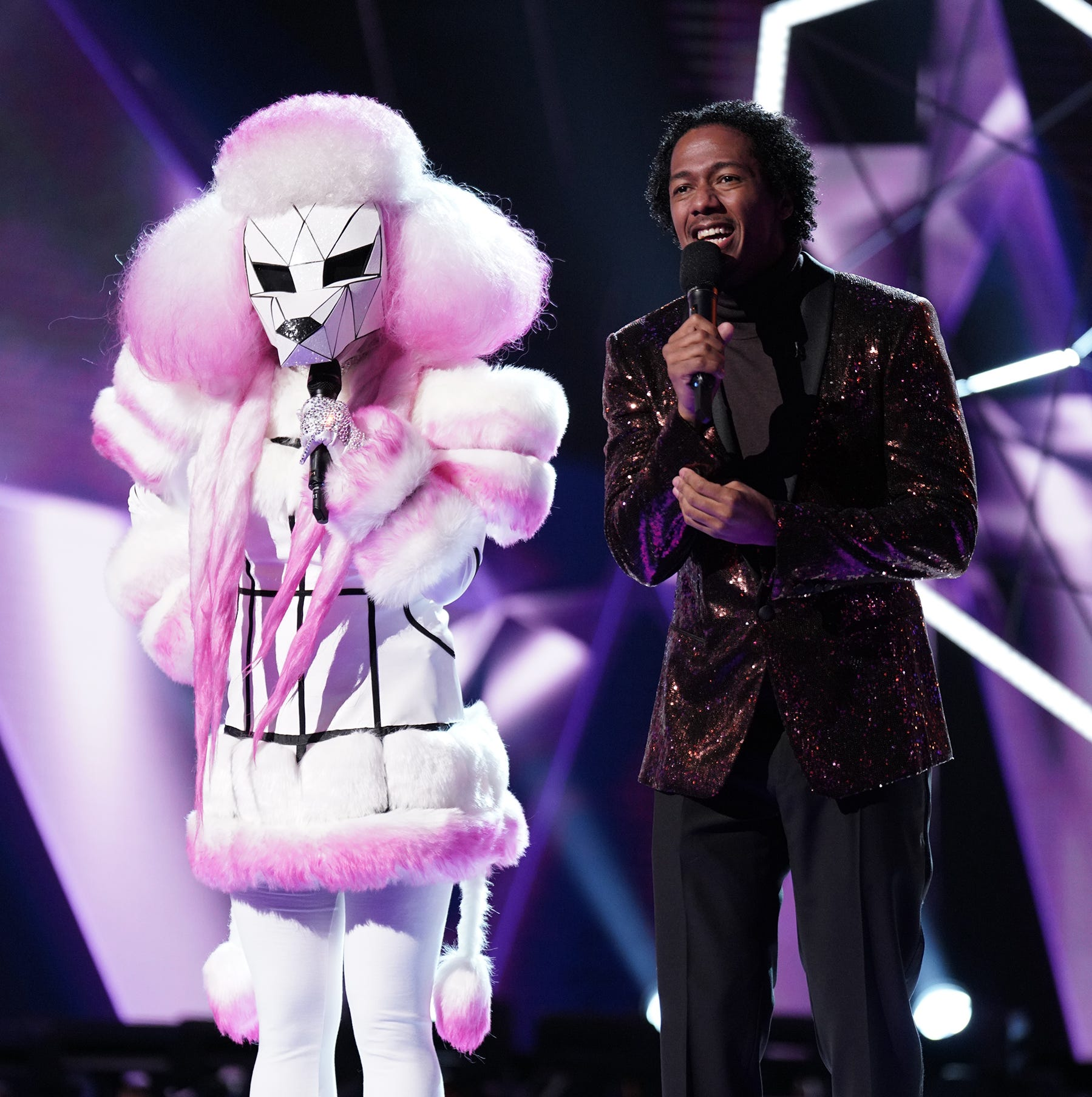 """The Poodle and host Nick Cannon on """"The Masked Singer."""""""