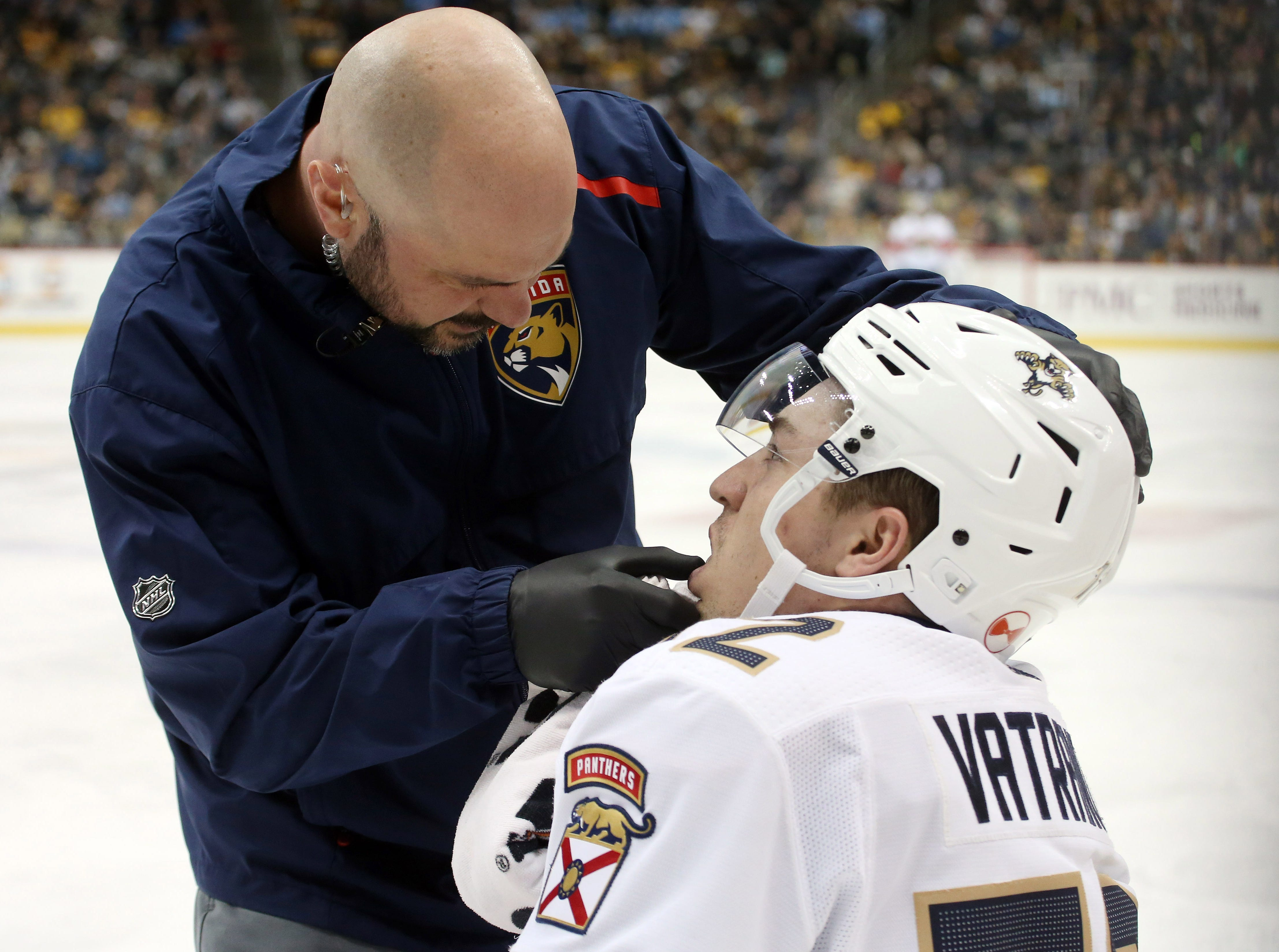 Jan. 8:  A Florida Panthers trainer checks the teeth of Frank Vatrano after the center was hit by Pittsburgh Penguins center Zach Aston-Reese.