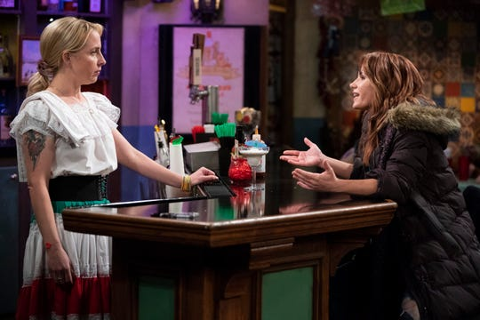 Persistent flirting by Becky (Lecy Goranson), left, leads to an angry confrontation with the girlfriend (Cheryl Texiera) of a man she's been texting on Tuesday's episode of ABC's 'The Conners.'