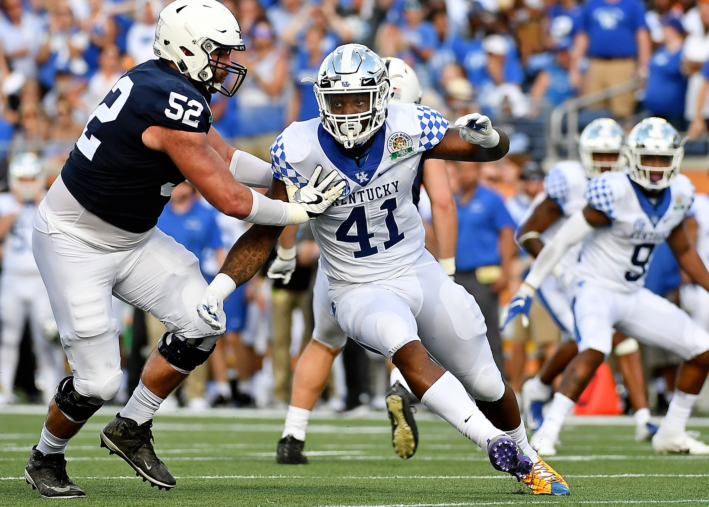 Kentucky linebacker Josh Allen pass rushes against Penn State offensive lineman Ryan Bates during the 2019 Citrus Bowl.