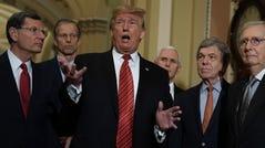 President Donald Trump speaks to members of the media as (L-R) Sen. John Barrasso (R-WY), Sen. John Thune (R-SD), Vice President Mike Pence, Sen. Roy Blunt (R-MO), Senate Majority Leader Sen. Mitch McConnell (R-KY) and Sen. Todd Young (R-IN) listen at the U.S. Capitol.