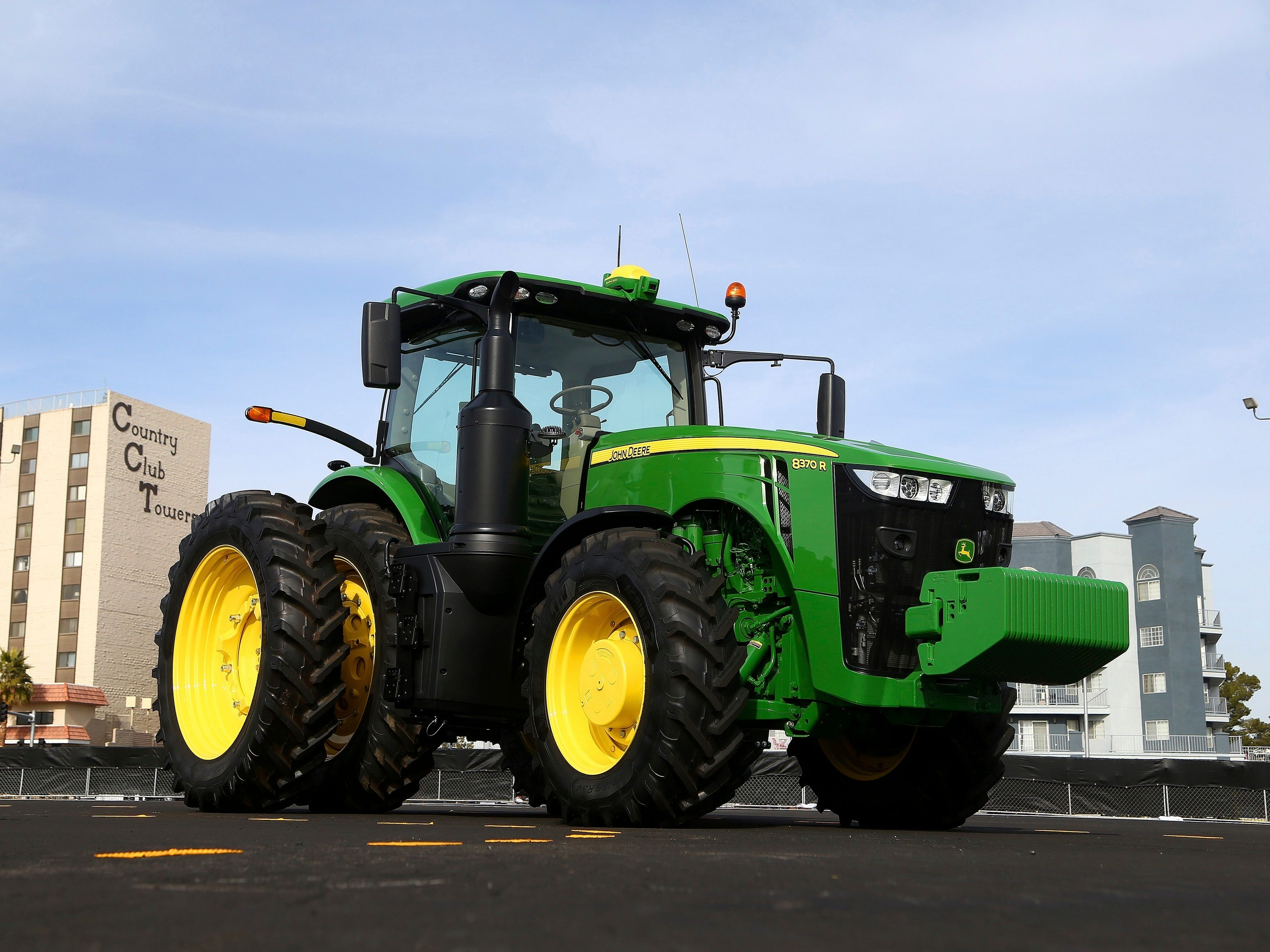 John Deere has hauled in a self-driving tractor aided by cameras with computer-vision technology to track the self-driving precision and program the route to be driven.
