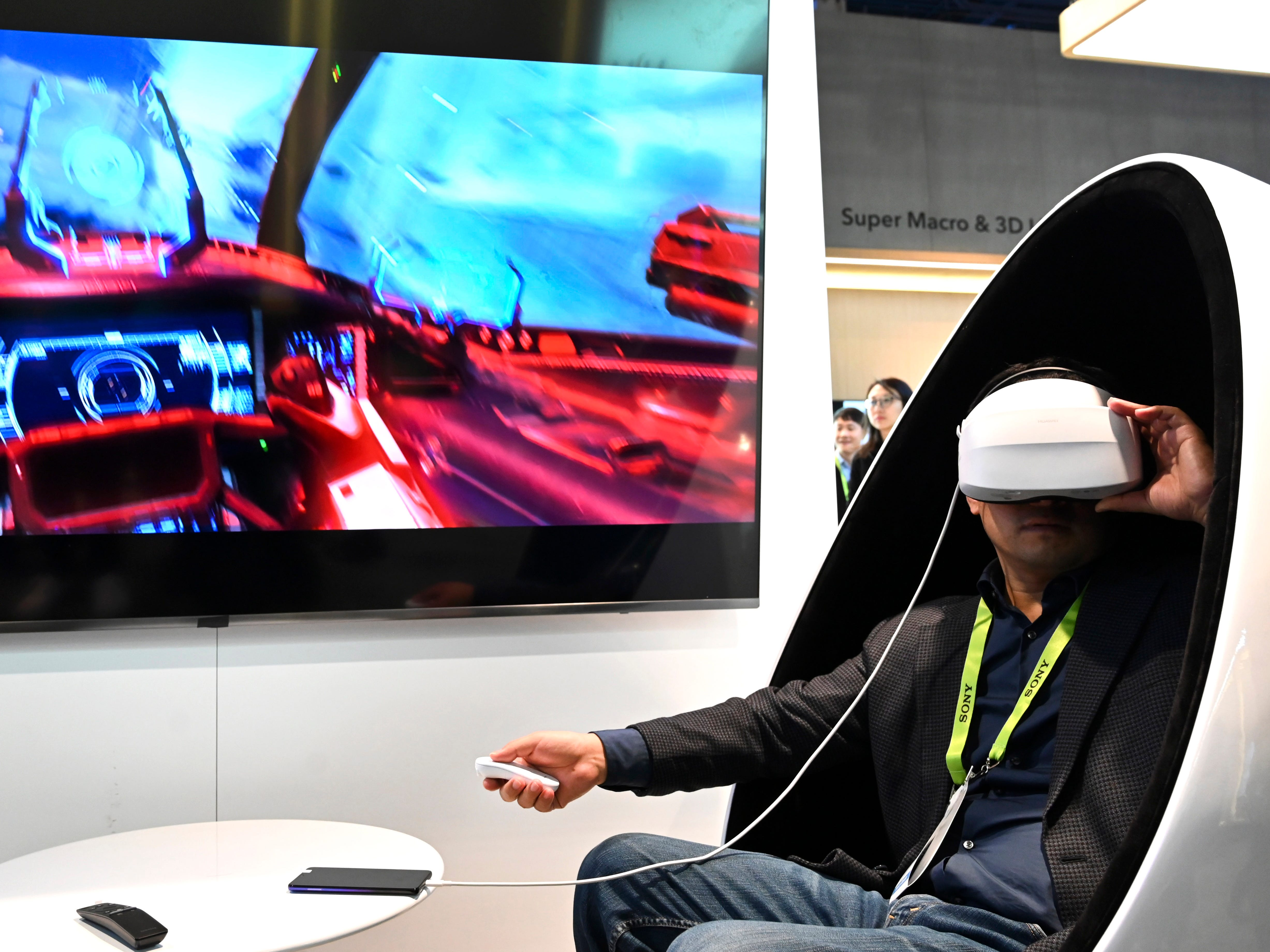 Jianing Zhang tries out a virtual reality gaming system by Chinese electronics maker Huawei that can run through the Internet or through a mobile phone.