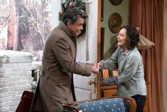 However, Darlene (Sara Gilbert), right, hoping for a big settlement, seems much happier meeting a lawyer (Peter Gallagher) than her injured father Dan does on Tuesday's episode of ABC's 'The Conners.'