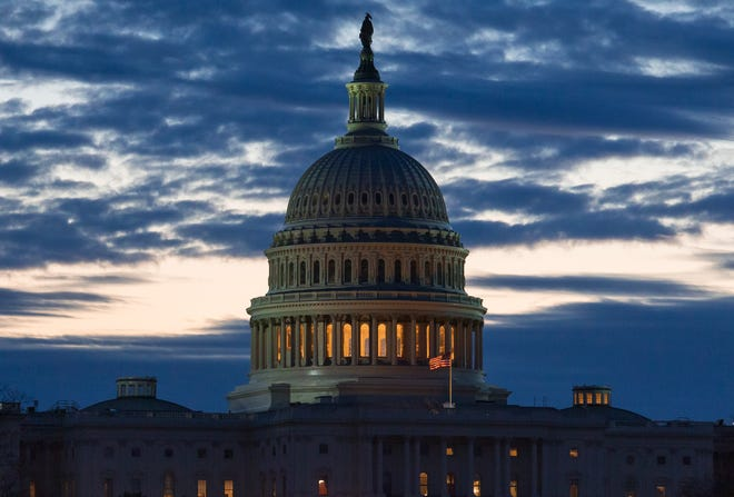 Dawn arrives at the Capitol in Washington, as the partial government shutdown enters day 19.