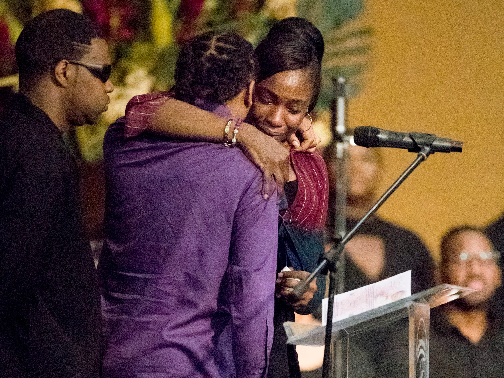 LaPorsha Washington and James Barnes embrace after speaking about their daughter Jazmine Barnes at her memorial service.