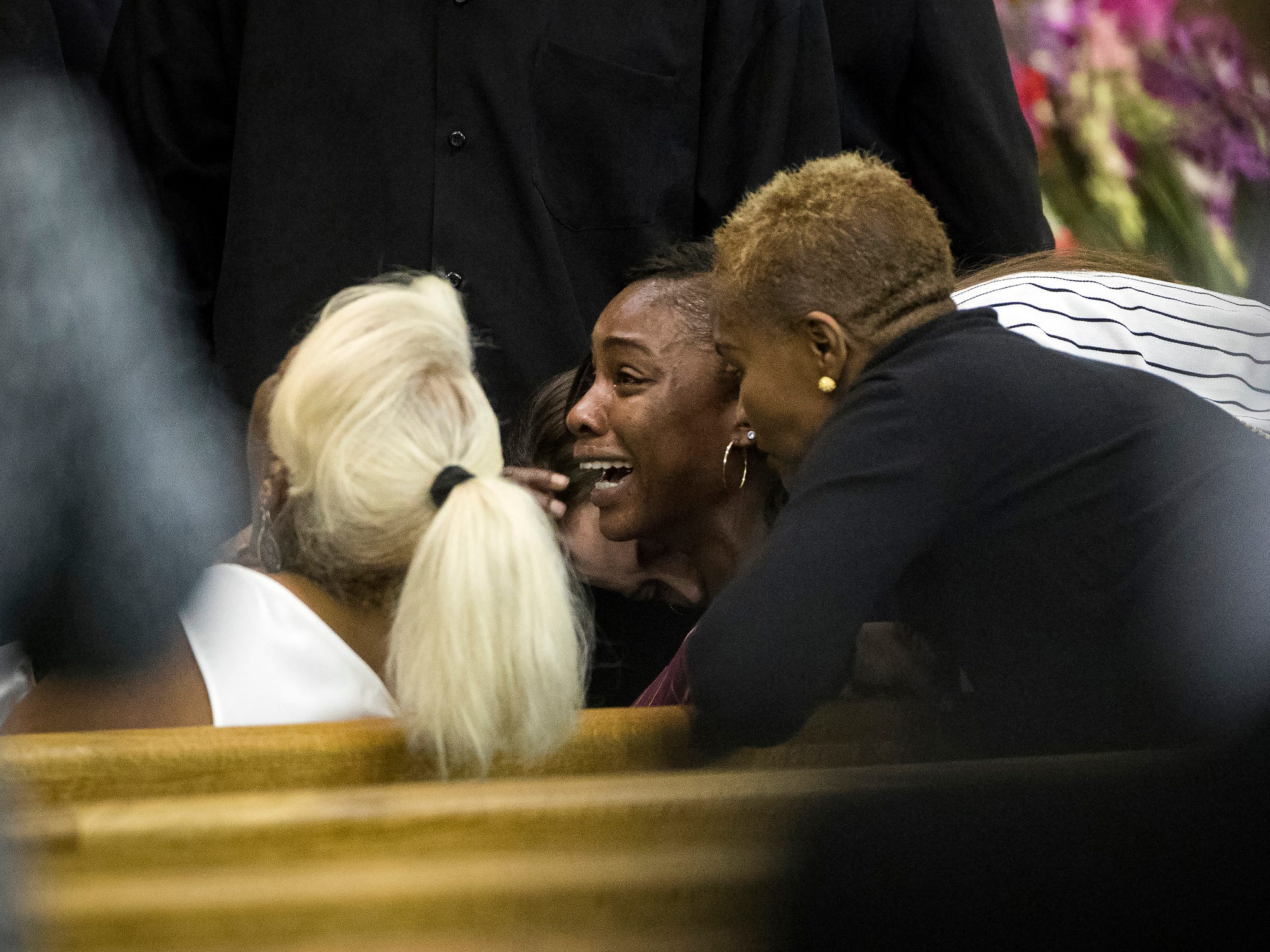 LaPorsha Washington, center, cries at the funeral of her 7-year-old daughter Jazmine Barnes.