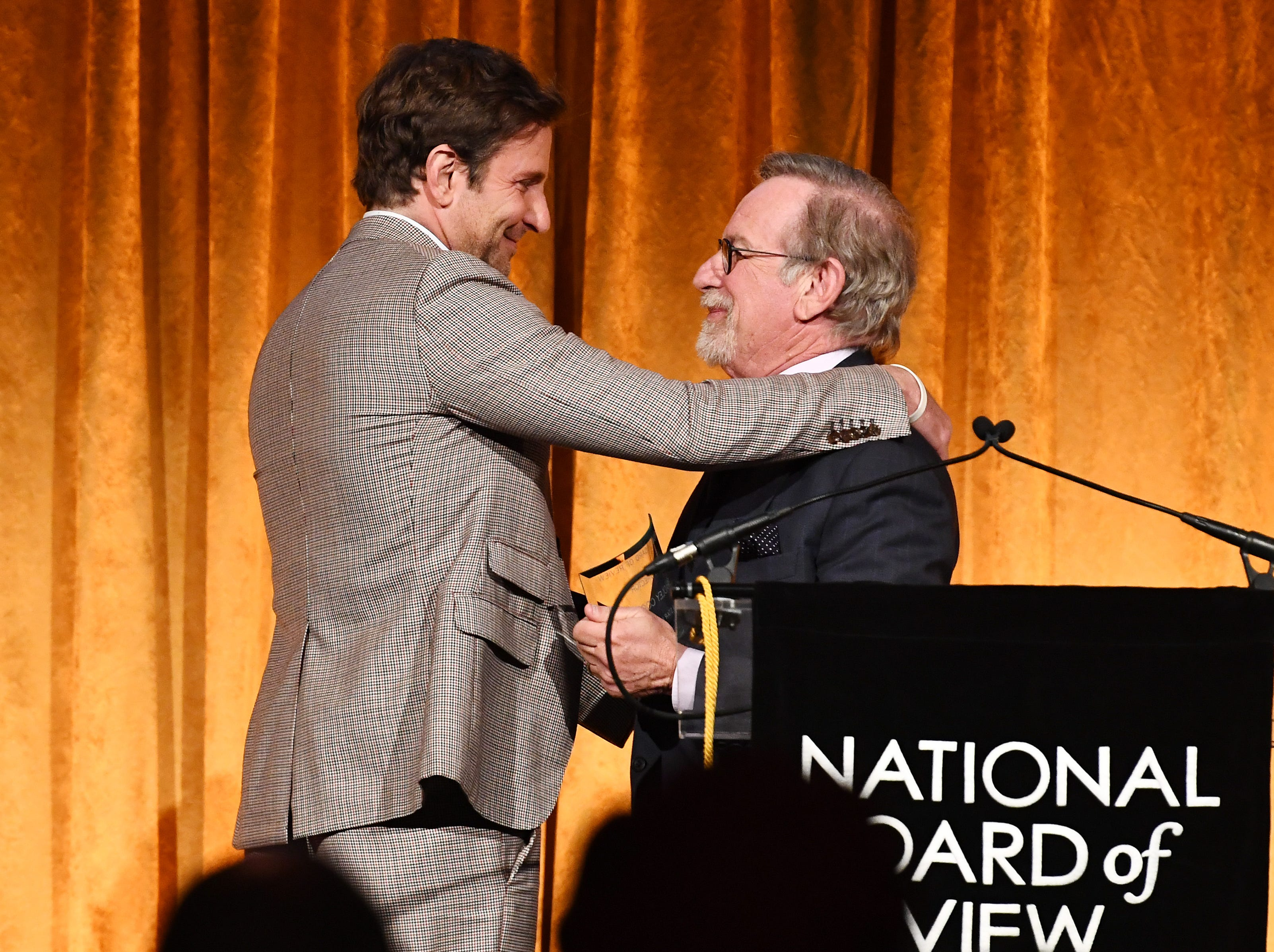 NEW YORK, NY - JANUARY 08:  Bradley Cooper accepts the Best Director award for A Star Is Born from Steven Spielberg during The National Board of Review Annual Awards Gala at Cipriani 42nd Street on January 8, 2019 in New York City.  (Photo by Dimitrios Kambouris/Getty Images for National Board of Review) ORG XMIT: 775277327 ORIG FILE ID: 1079462160