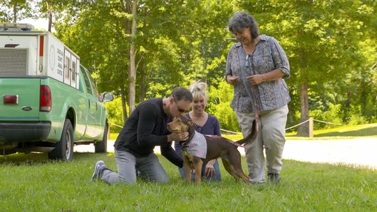 """A Dog's Way Home"" author W. Bruce Cameron, wife Cathryn Michon (who co-wrote the movie) and dog trainer Teresa Ann Miller pick up Shelby the dog from the shelter."