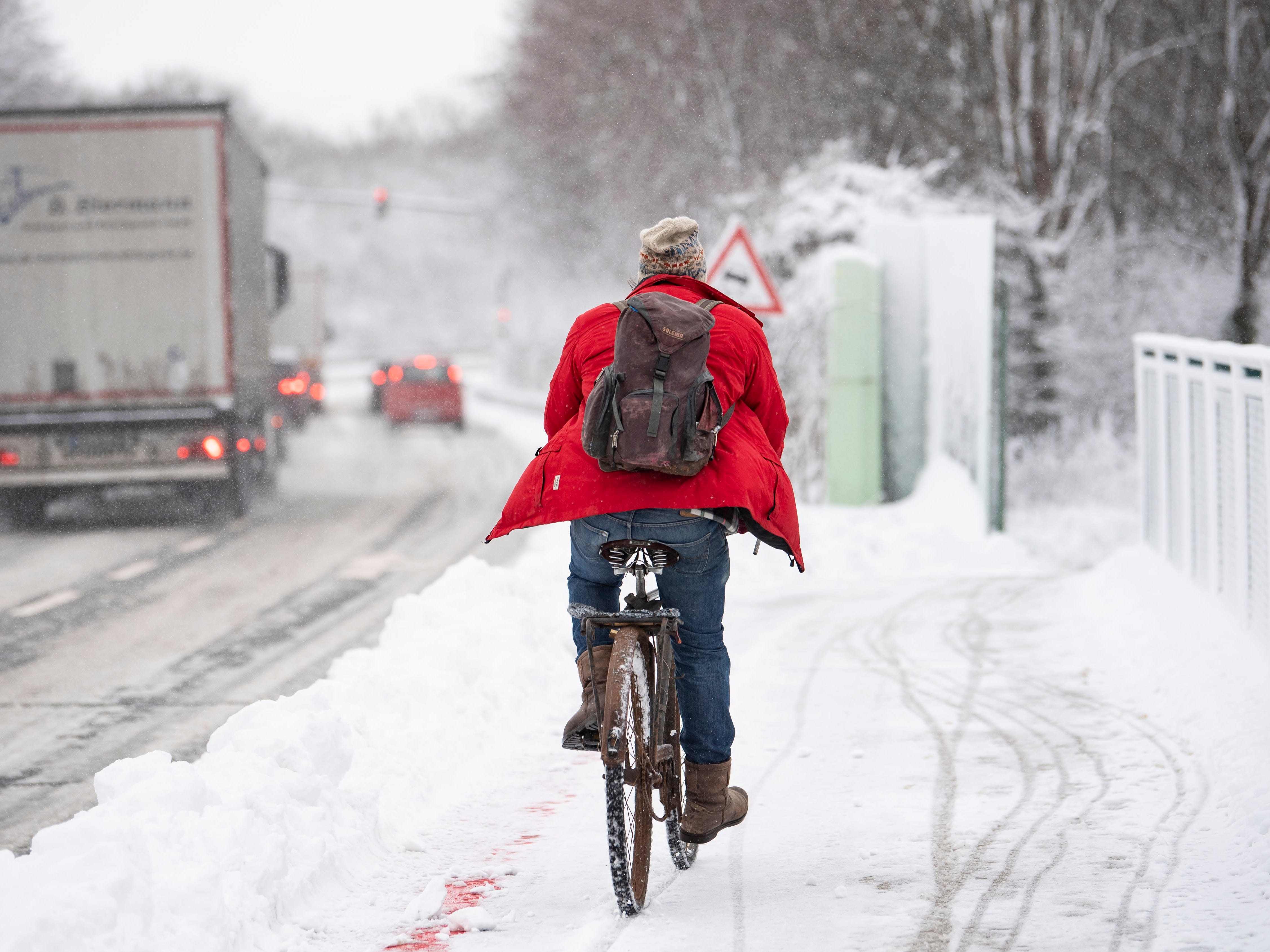 A cyclist rides on a snow-covered road near Munich, Bavaria, Germany,  Jan 9. 2019.