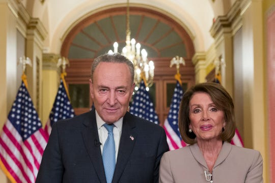 Senate Minority Leader Chuck Schumer of N.Y., and House Speaker Nancy Pelosi of Calif., pose for photographers after speaking on Capitol Hill in response President Donald Trump's address, Tuesday, Jan. 8, 2019, in Washington.
