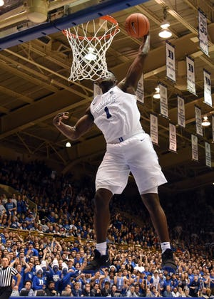 Duke Blue Devils forward Zion Williamson (1) dunks during the second half against the Clemson Tigers at Cameron Indoor Stadium.