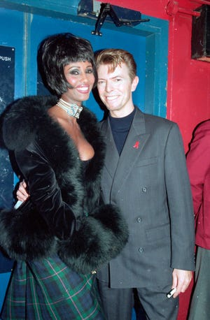 Here's a photo from 1993 of David Bowie and Iman. Bowie passed away in 2016.