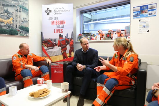 Prince William takes time to chat while visiting London's Air Ambulance Charity at the The Royal London Hospital.