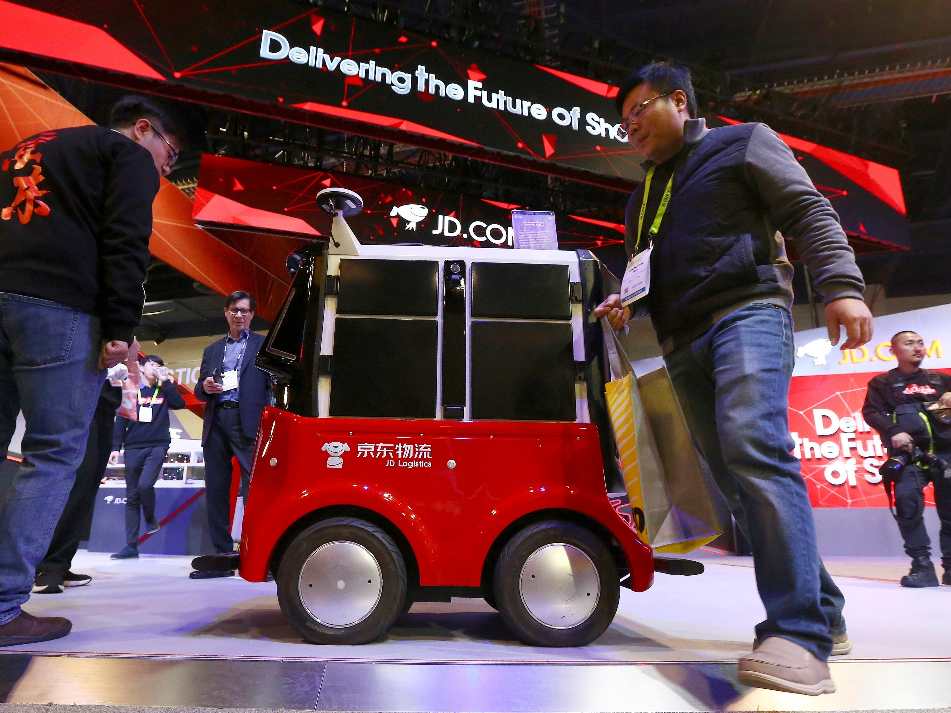 CES attendees check out the autonomous delivery robot vehicle.