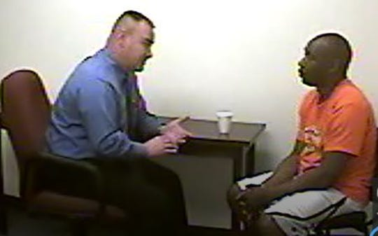 Anderson County Sheriff's Office investigator Todd Owens questions Marcus Brown on the morning after the April 13, 2014, fatal shooting of Leandus Pickens.