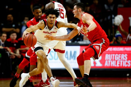 Jan 9, 2019; Piscataway, NJ, USA; Rutgers Scarlet Knights guard Geo Baker (0) dribbles the ball against the Ohio State Buckeyes during the first half at Rutgers Athletic Center (RAC).