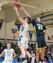 Freehold Township's Zach Orrico puts up a shot as Marlboro's Nicholas Lugo defends. Marlboro vs Freehold Township basketball.  Freehold Township, NJ Thursday, January 10, 2019