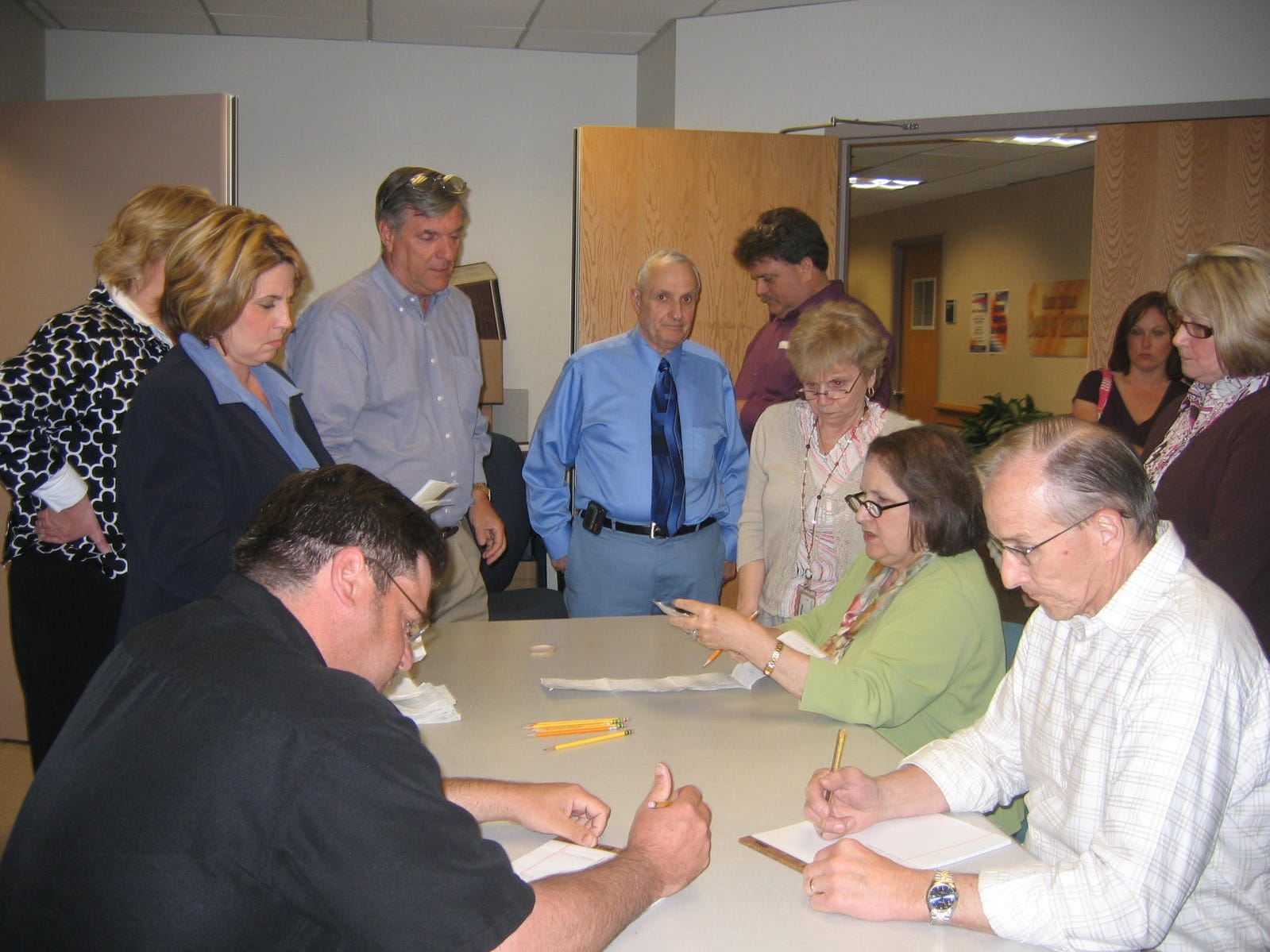 Times-Beacon photo by Paula Scully 5/12/09  George Gilmore, center, standing, and employees of the Ocean County Board of Elections, go over procedure for a vote recount May 12 in recount of write-in votes for the two top vote getters for a vacant three-year seat in the Little Egg Harbor School District elections held April 21.