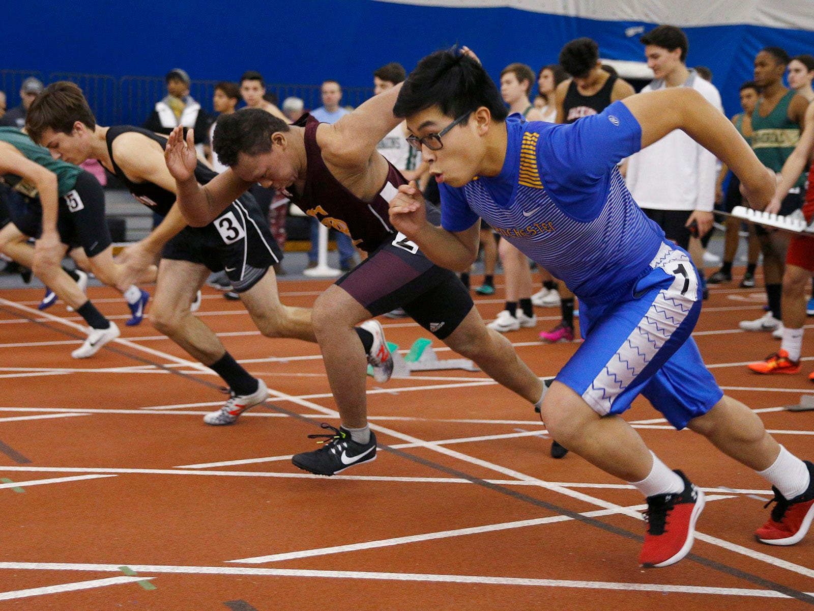 Runner jump off the blocks at the start of the 55m sprint during the Ocean County Indoor Track Championships at the Bennett Indoor Complex in Toms River Wednesday, January 9th, 2019.