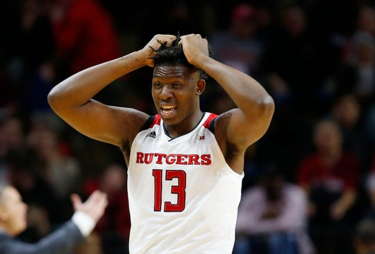 Jan 9, 2019; Piscataway, NJ, USA; Rutgers Scarlet Knights forward Shaq Carter (13) reacts after an apparent injury to forward Eugene Omoruyi (not pictured) during the first half against the Ohio State Buckeyes at Rutgers Athletic Center (RAC).